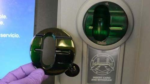 Image of a debit card skimmer at an ATM