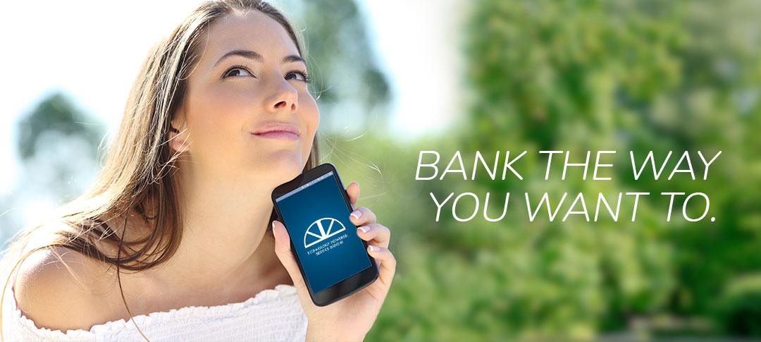 Bank the way you want to. Woman using The Bank of Marion app.