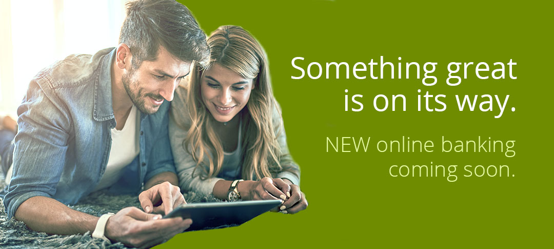 Something great is on its way. Man and woman looking at a tablet.